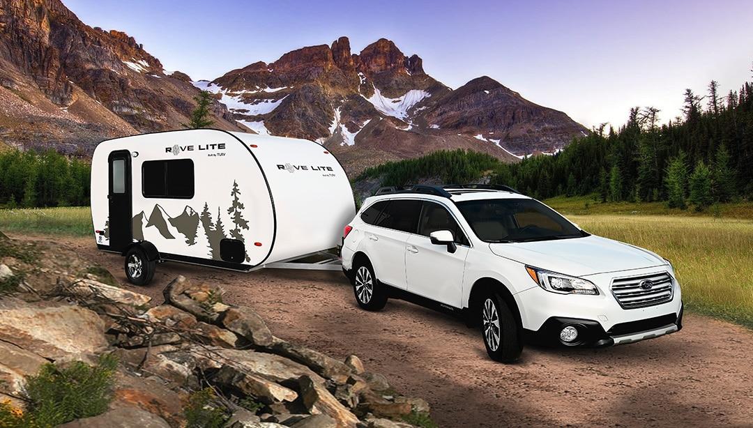 Ultra-Lite Travel Trailer Towed By Subaru Sedan